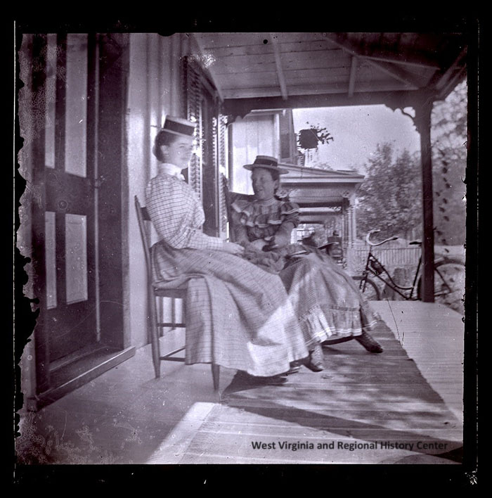 Image of two unidentified women on the porch of Marble Hall