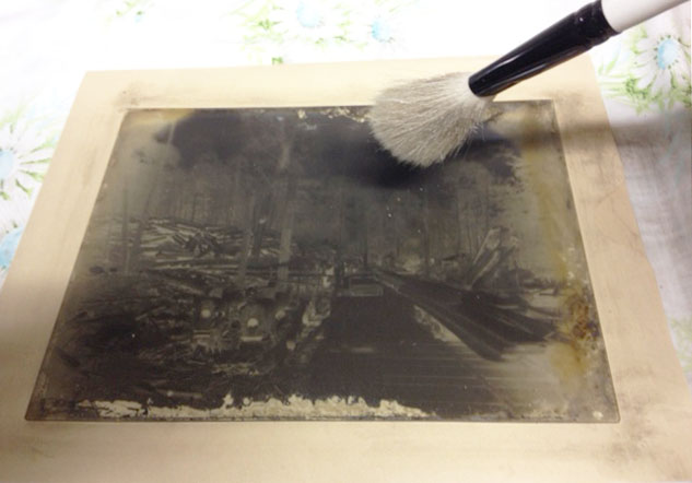 Glass plate slide being brushed