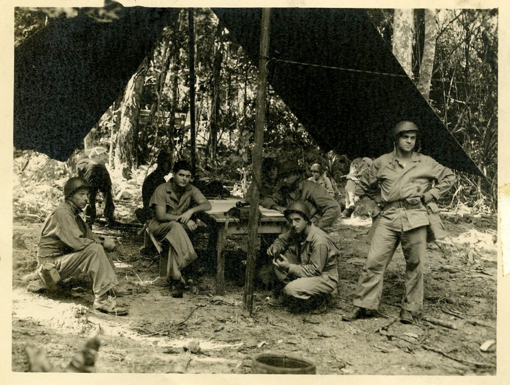 Williamson, on right, with his buddies on Espirito Santo, January 25, 1944. He notes on the back of this photo that the pouch on his side is a first aid kit.