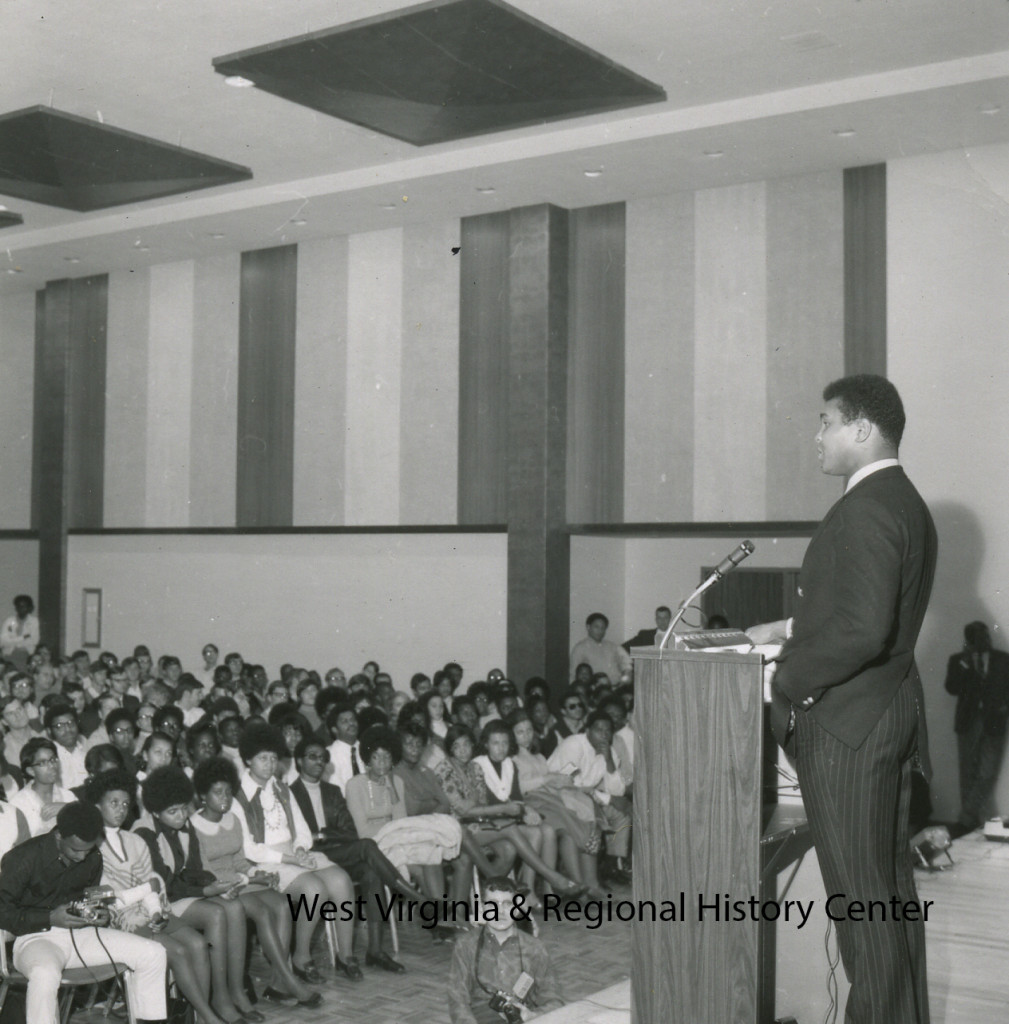 Muhammad Ali at podium, speaking at WVU