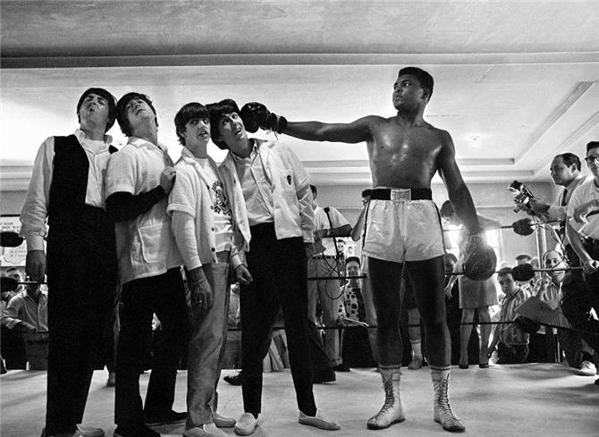 Muhammad Ali (Cassius Clay at the time in 1964) pretends to punch the Beatles. Photograph copyright Charles Trainor.