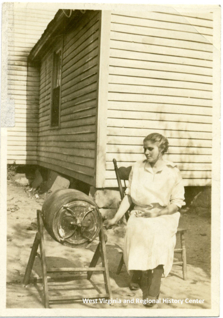 Woman sitting at a butter churner