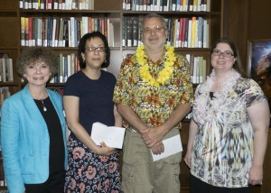 Thea Browne, Library Staff Association Staff Person of the Year, and Joe Morasco, Library Staff Association Continuing Excellence Award winner, pose with Associate Dean of Libraries Myra N. Lowe and LSA Chair Jennifer Dubetz.