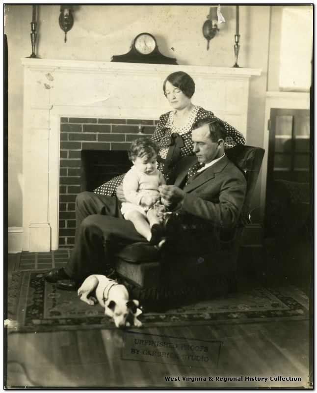 Couple Sitting with a Child, Martinsburg, W. Va.