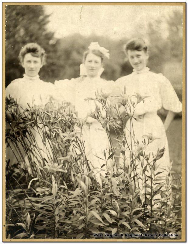 Margaret, Gertrude and Calora Hardway standing in garden, Lost Creek, W. Va.