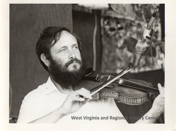 Frank George playing fiddle