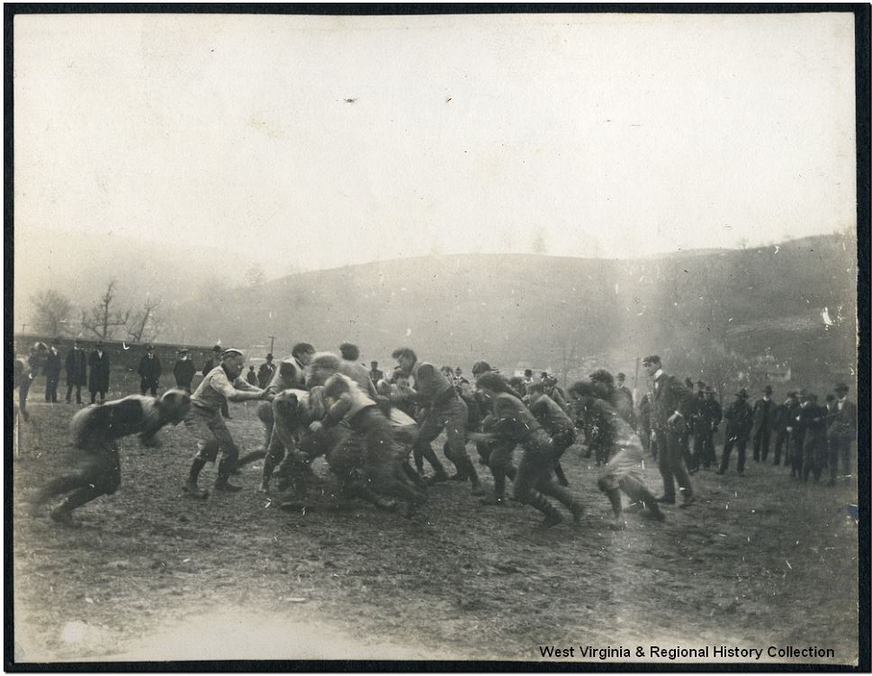 This photo shows the muddy, helmet-optional state of turn-of-the-century WVU football games