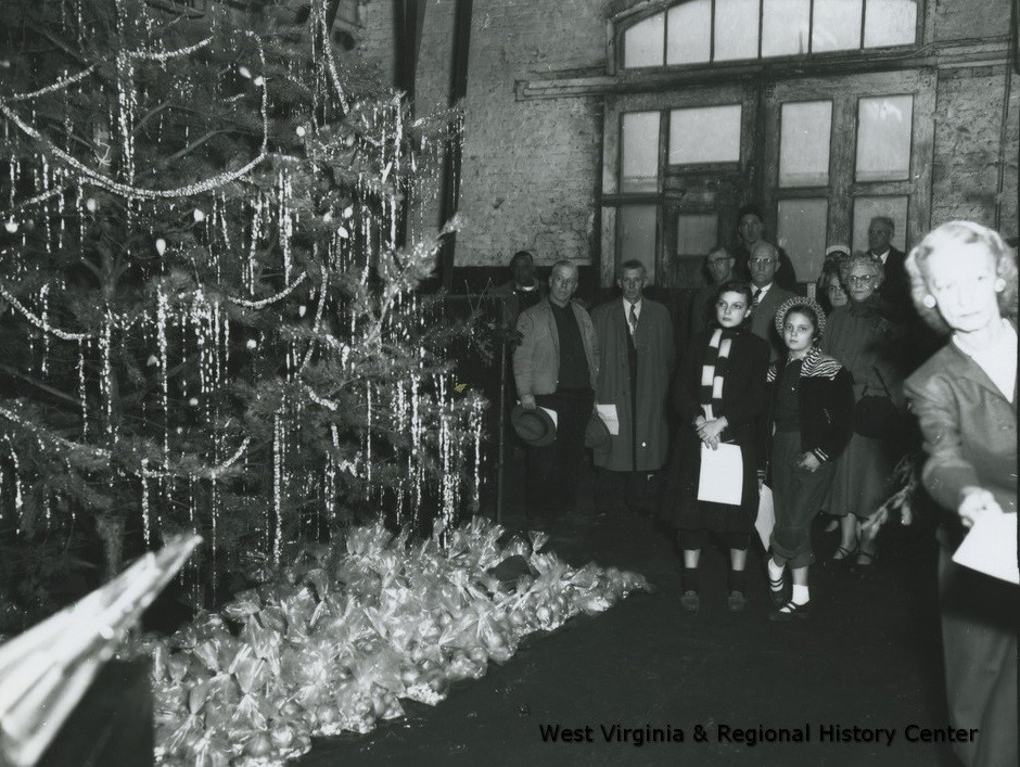 •	C&O Shop's Christmas Party, with tree and onlookers
