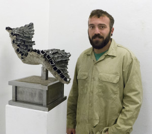 Matthew Gillette with his sculpture Slumped.