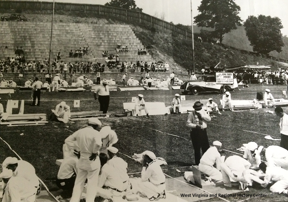Miners practicing first aid on a field in Mount Hope