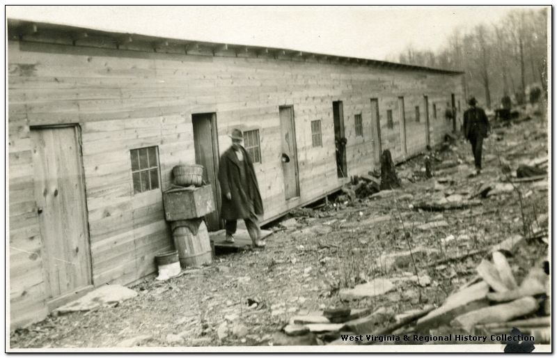 Men outside Barracks at Meriden, Barbour County, West Virginia