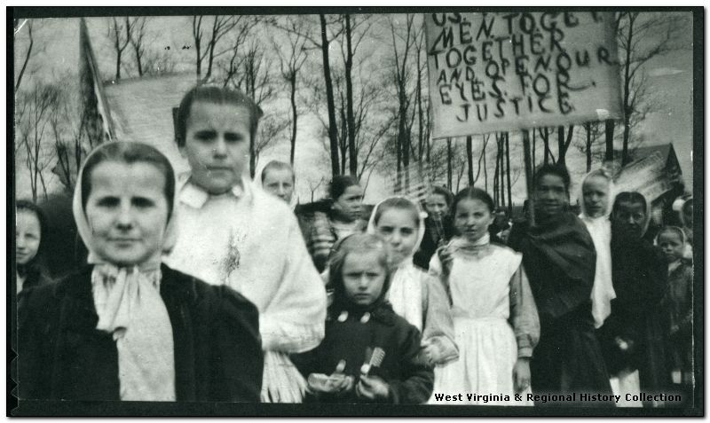 Women and children with union sign, location unknown