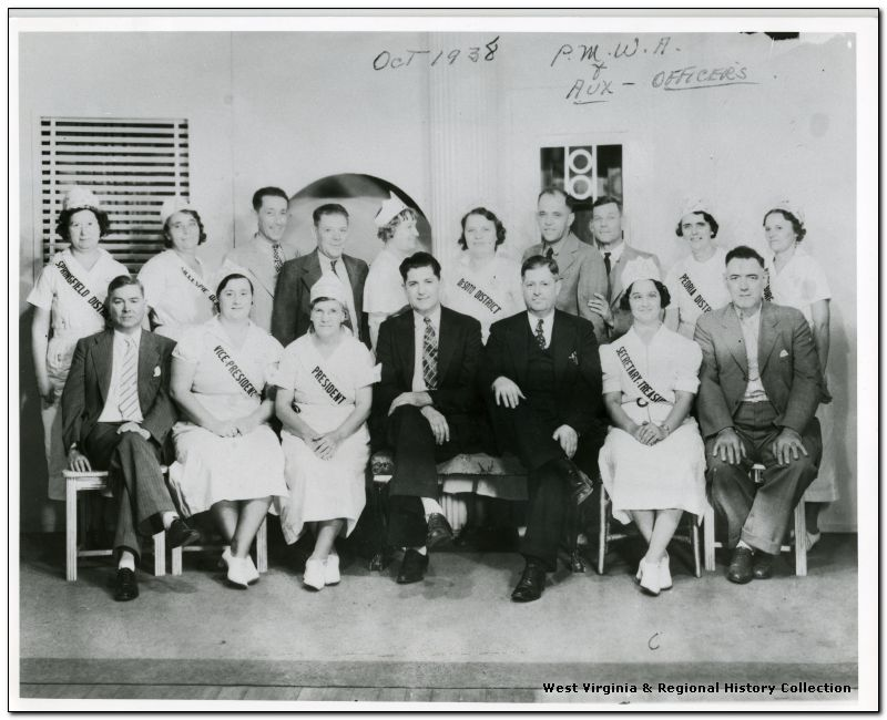 Group portrait of Officers of the Progressive Mine Workers of America and Women's Auxiliary, October 1938
