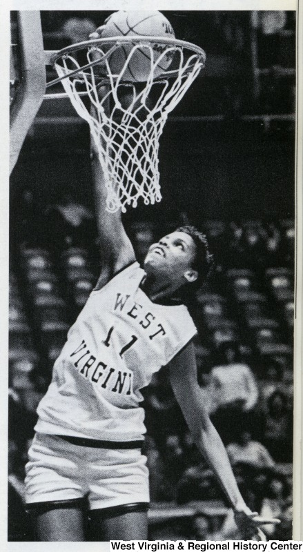 Georgann Wells dunking a basketball