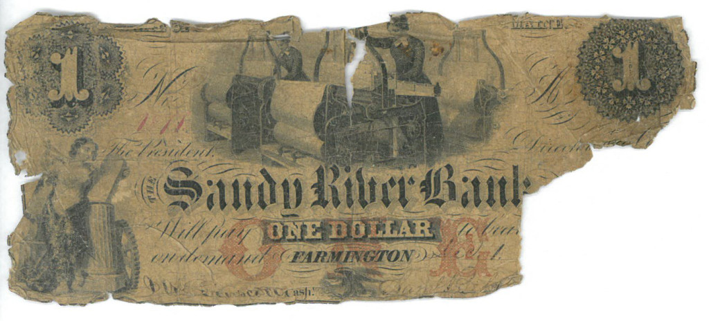 Damaged $1 note from the Sandy River National Bank of Farmington in Maine