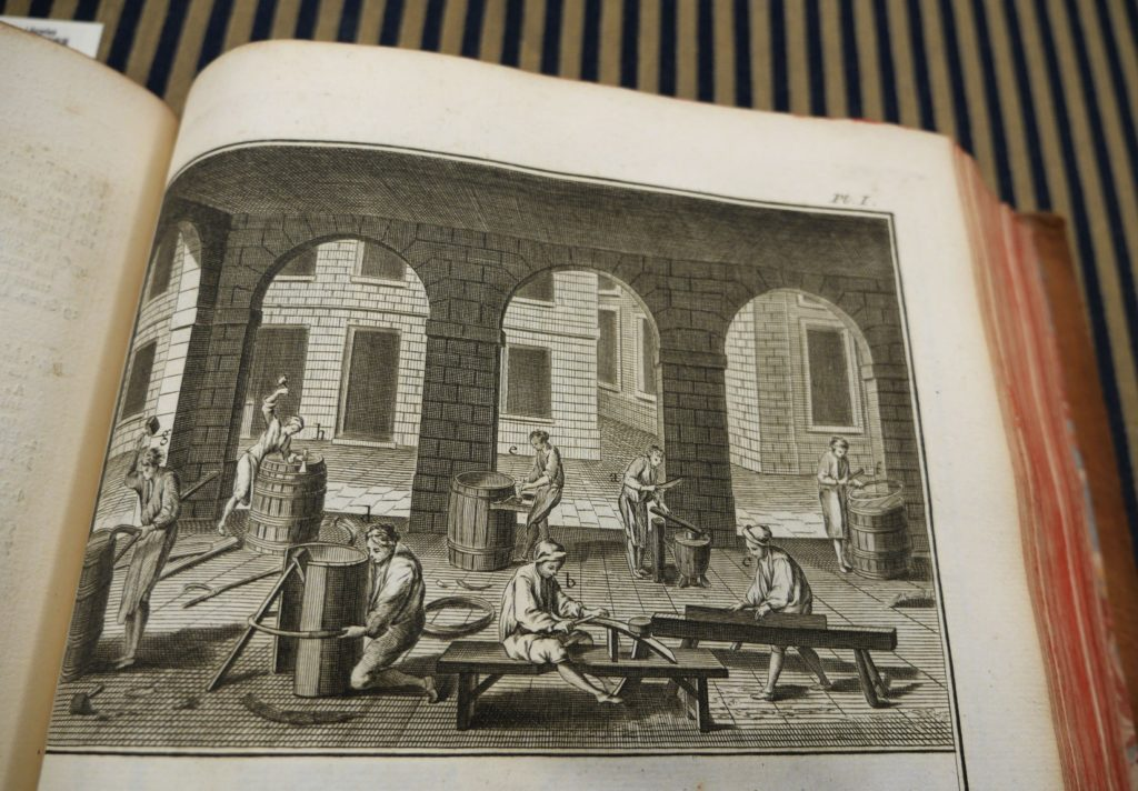 Plate depicting workers making stringed instruments