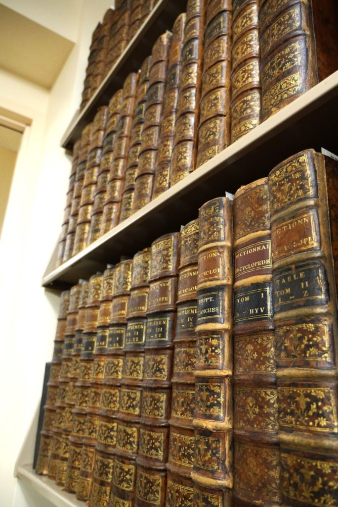 Shelves containing volumes of Diderot's Encyclopedia