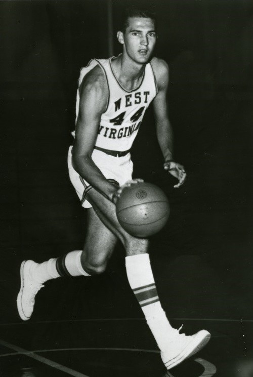 Action shot of Jerry West playing WVU basketball
