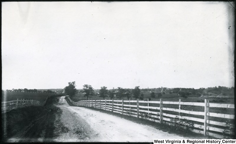 Scenic view of road surrounded by fences and fields in Charles Town