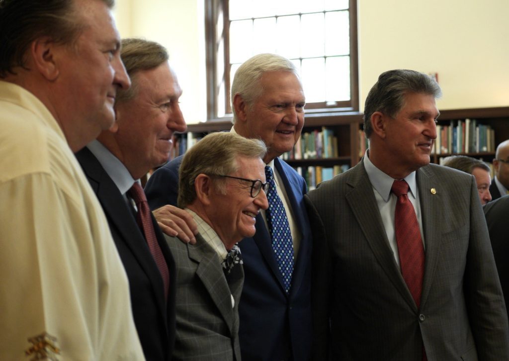 Group photo of Bob Huggins, Rod Thorn, President Gee, Jerry West, and Senator Joe Manchin