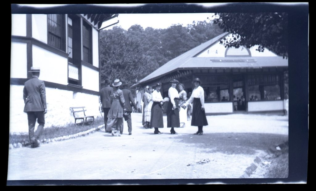 Family looking at camera with Oakford Park Restaurant in Background