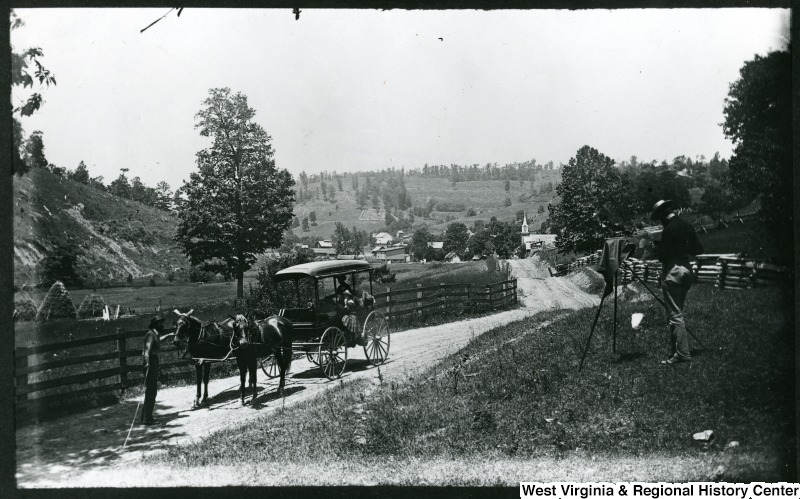View of road in Auburn, Ritchie COunty, WV, showing horses and buggy