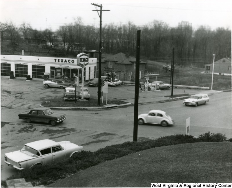 Texaco and vintage cars at the intersection of University Ave. and Patteson Dr. in Morgantown, ca. 1960s-1970s
