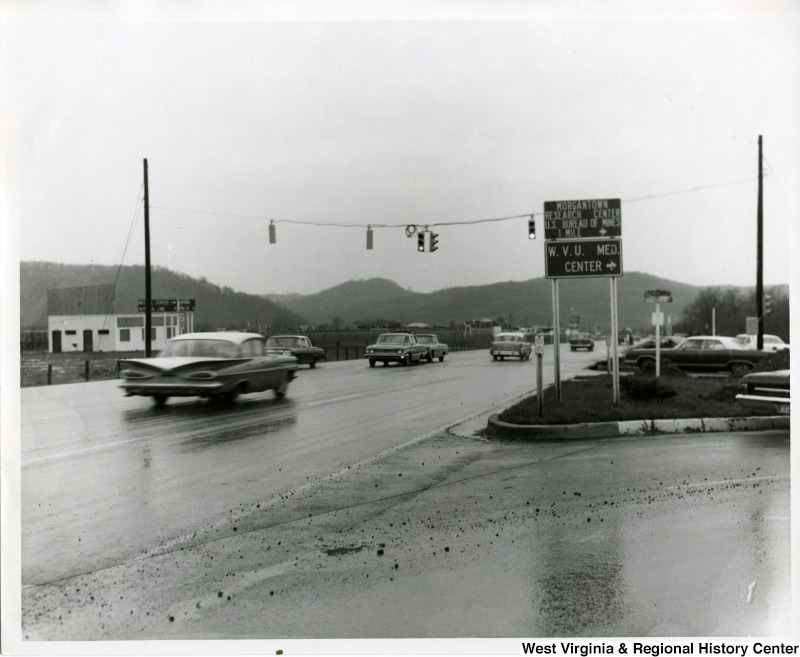 Cars driving through the intersection of Monongahela Boulevard and Patteson Drive in Morgantown, WV, 1966