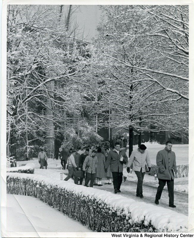 Students walking through WVU campus in the snow