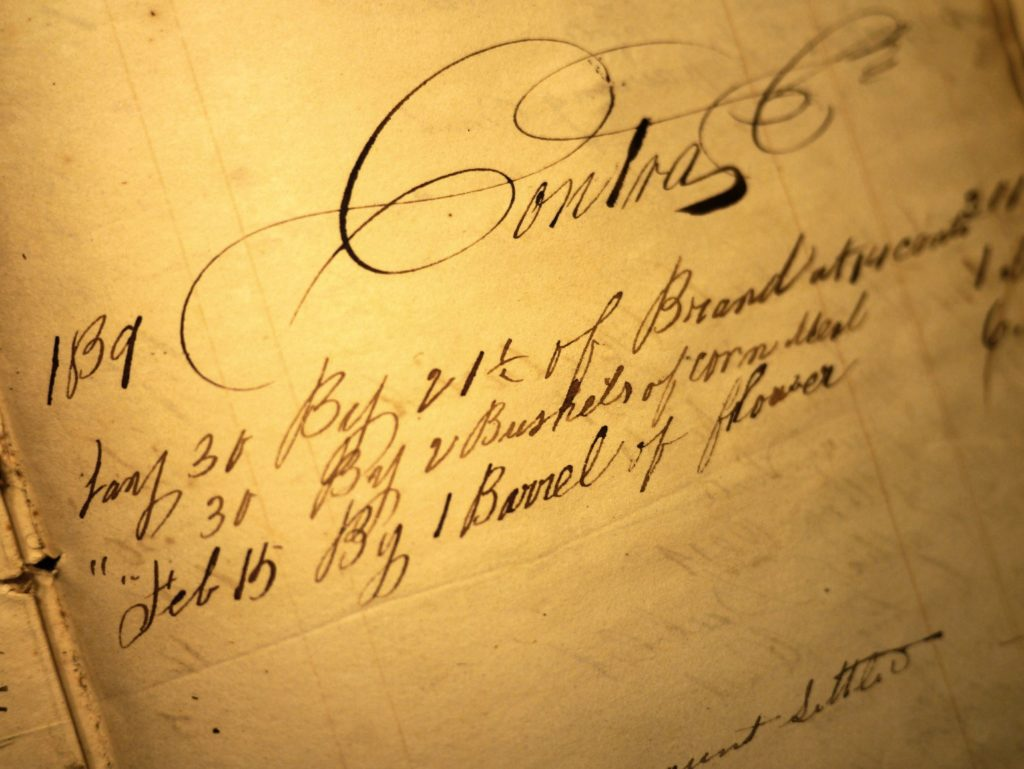 Record of Payment by Nimrod Dent for clothing, including bushels of corn and a barrel of flour