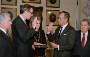 Vice President George H. W. Bush administering oath to Senator John D. (Jay) Rockefeller. Rockefeller is joined by his wife, Sharon, Senator Robert C. Byrd and former Senator Jennings Randolph, whom he succeeded. Senate Photographic Studio, January 15, 1985.