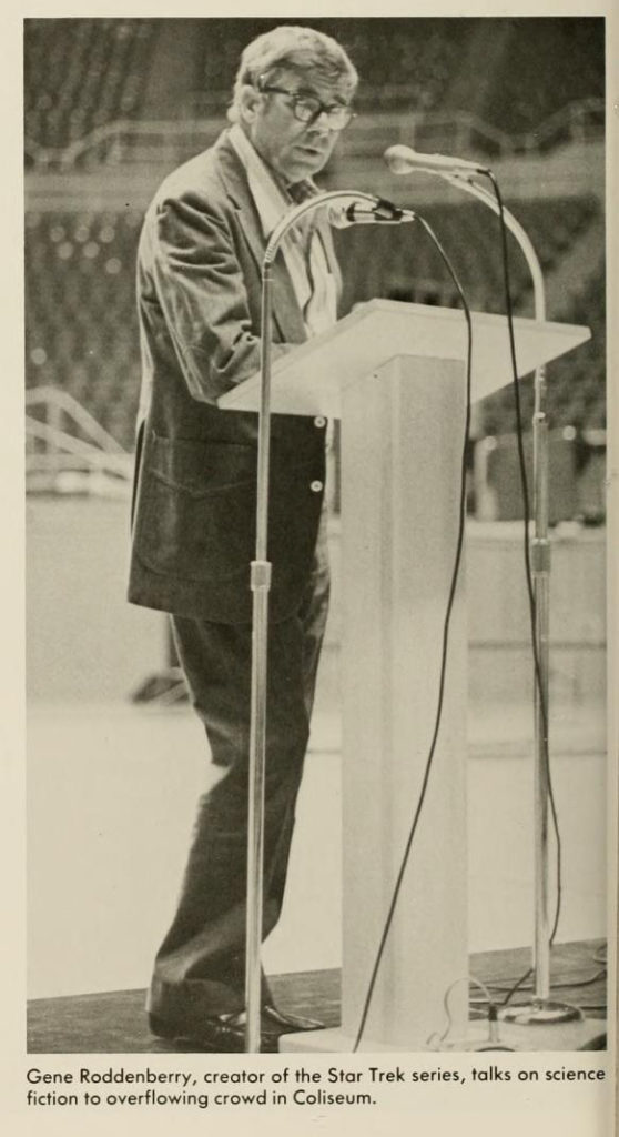 Gene Roddenberry standing at podium in WVU Coliseum