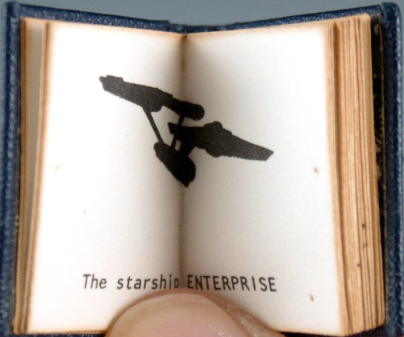 Book pages showing sketch of the starship Enterprise