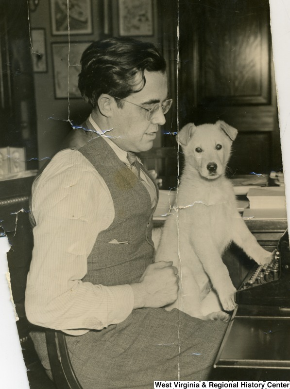 Senator Rush D. Holt With Dog on Lap at Typewriter