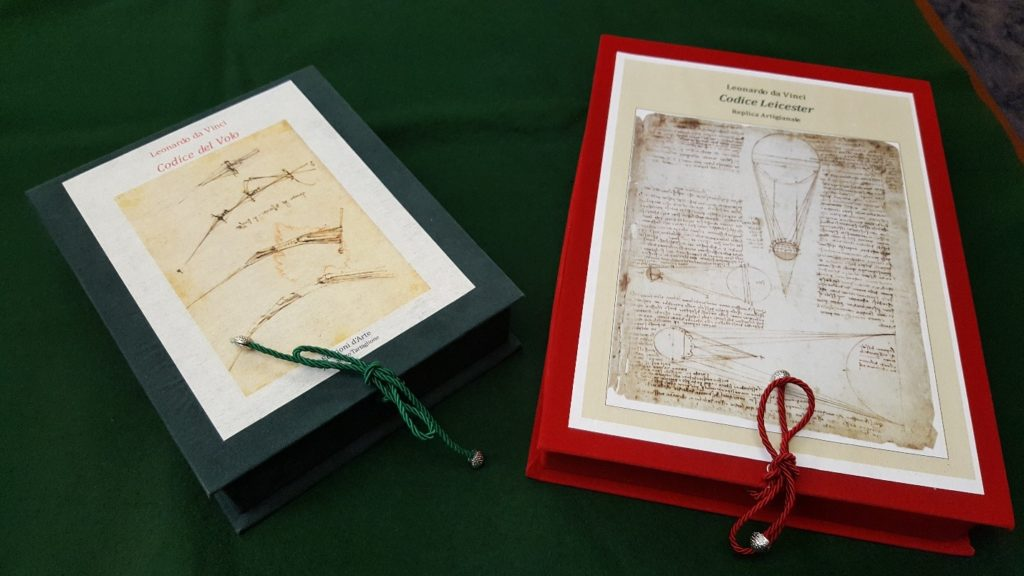 Replicas of The Codice Leicester and Codice del Volo in their protective boxes
