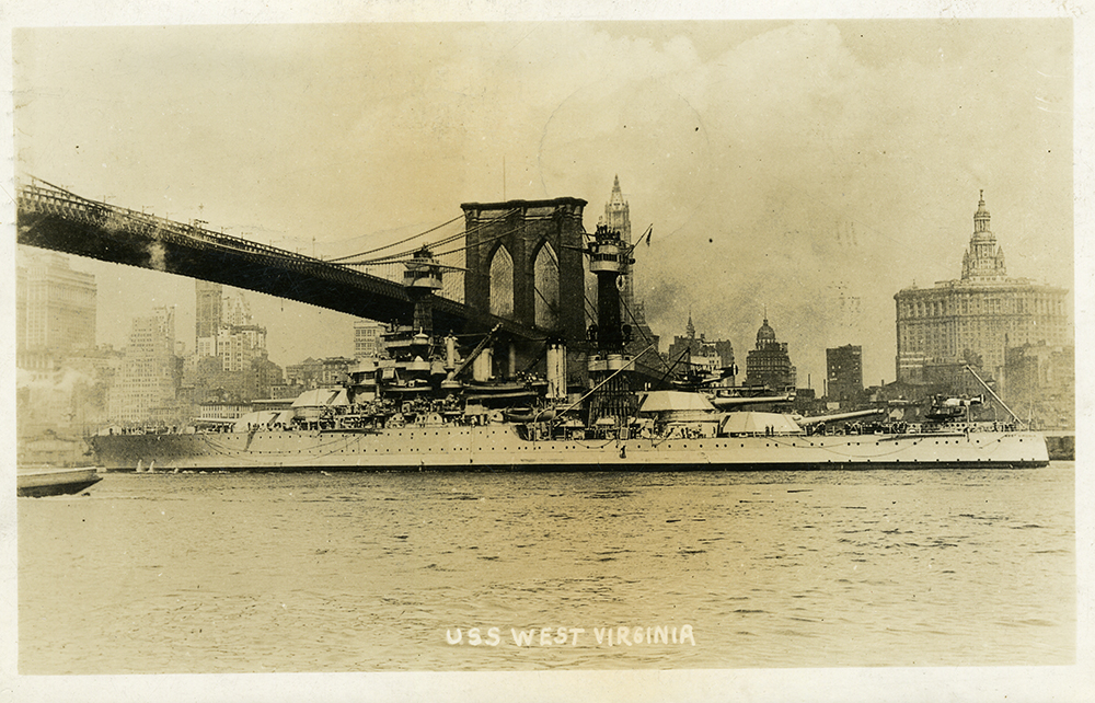 USS West Virginia sails under the Brooklyn Bridge, ca. 1936