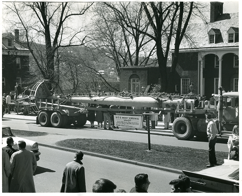 The mast of the USS West Virginia arrives on the WVU Campus, March 17, 1961, on the bed of a truck