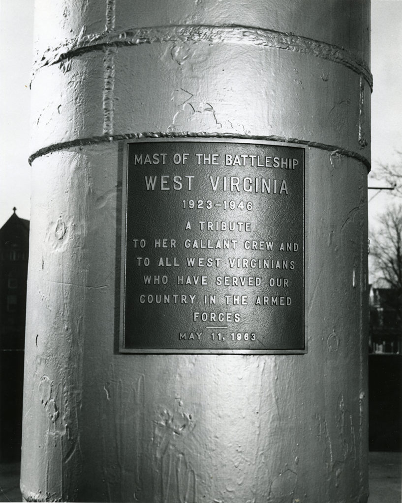 "Plaque on the mast of the USS West Virginia which says ""A tribute to her gallant crew and to all West Virginians who have served our country in the armed forces."""