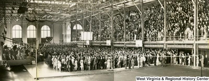 Crowd Inside of Field House Watching 'It's Wheeling Steel'