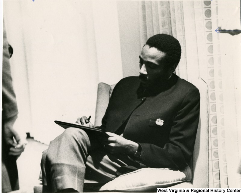 Comedian and Anti-War Activist Dick Gregory, seated