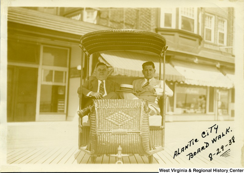 Joe Ozanic (on right) and another man sitting in a cart at the Atlantic City Boardwalk