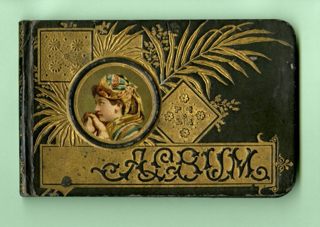 Cover of autograph book with portrait of woman on it