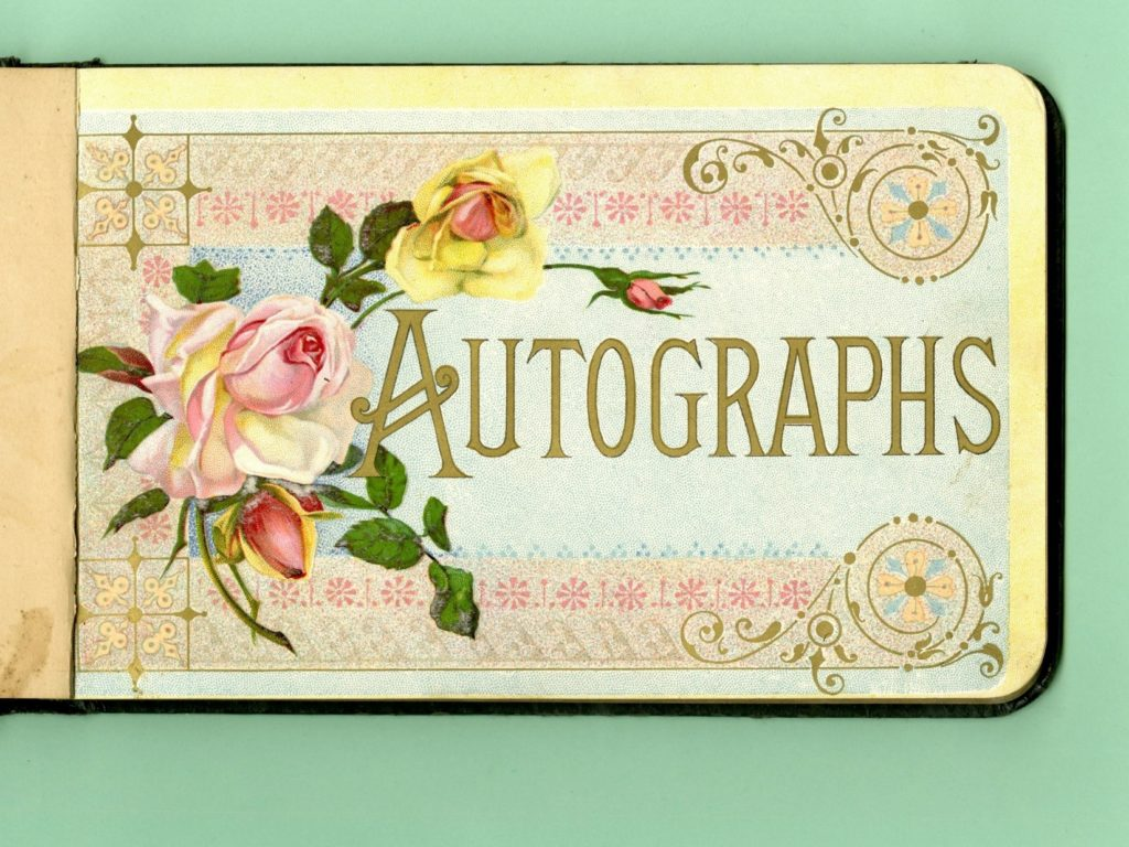 Title page of autograph book with colored flowers on it