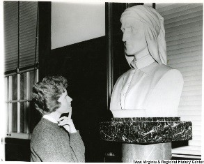 Woman looking at bust of Dante