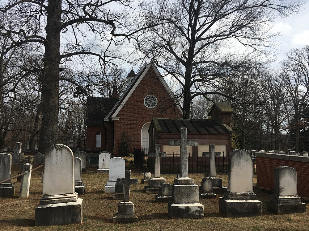 Exterior of St. Thomas Episcopal Church in Baltimore Maryland, with gravestones