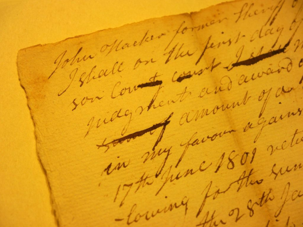 "Detail of Handwritten Court Record Featuring Name of Pioneer John Hacker, Referencing Him as ""Former Sheriff"", 1809"