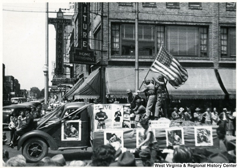 July 4 parade float reenacting the WWII flag raising at Iwo Jima