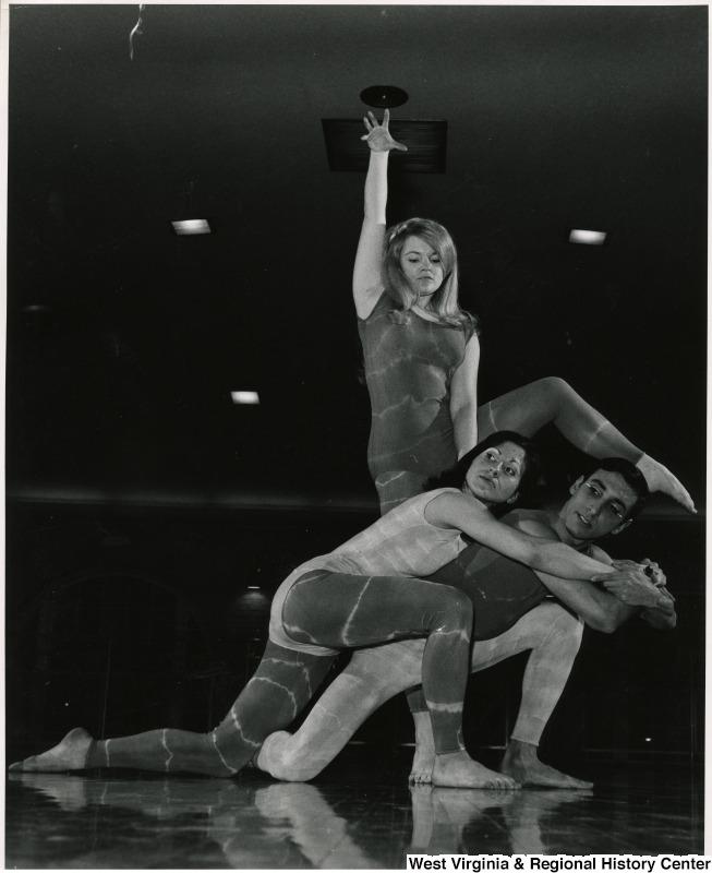 Three WVU Orchesis dancers in costume