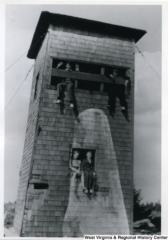 Children in an old fire watch tower on Spruce Knob in 1938