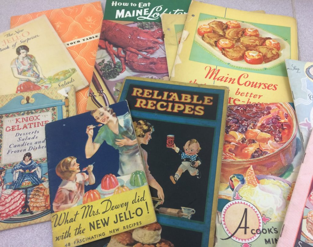 Colorful assortment of old cooking pamphlets